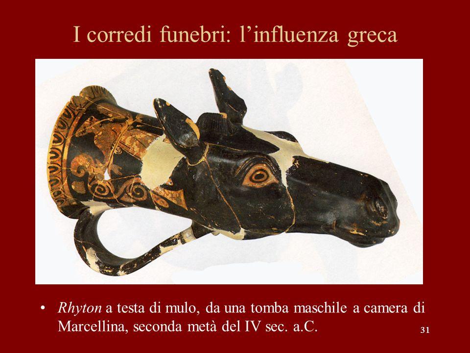 31 I corredi funebri: l'influenza greca Rhyton a testa di mulo, da una tomba maschile a camera di Marcellina, seconda metà del IV sec. a.C.