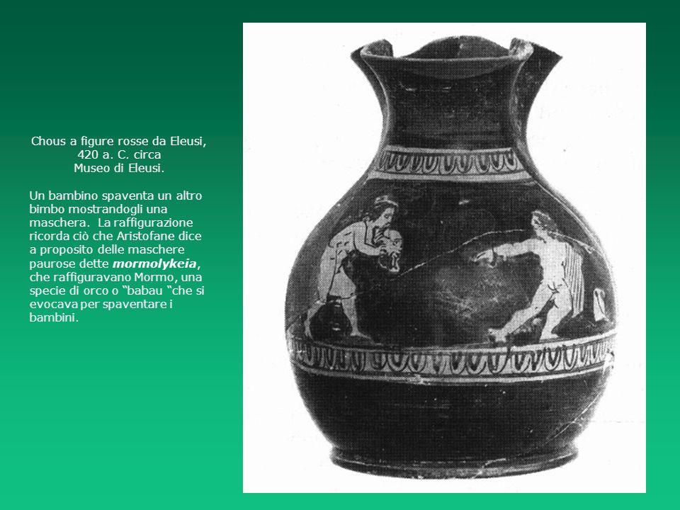 Chous a figure rosse da Eleusi, 420 a. C. circa Museo di Eleusi. Un bambino spaventa un altro bimbo mostrandogli una maschera. La raffigurazione ricor