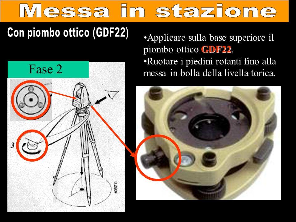 Fase 2 GDF22Applicare sulla base superiore il piombo ottico GDF22. Ruotare i piedini rotanti fino alla messa in bolla della livella torica.