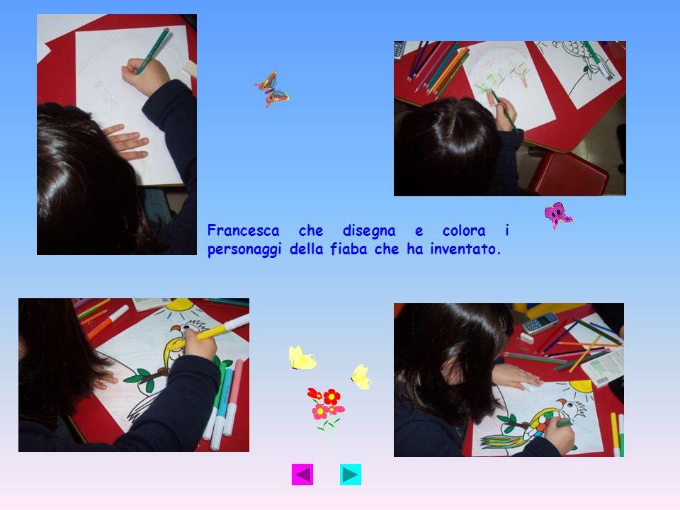 Francesca che disegna e colora i personaggi della fiaba che ha inventato.