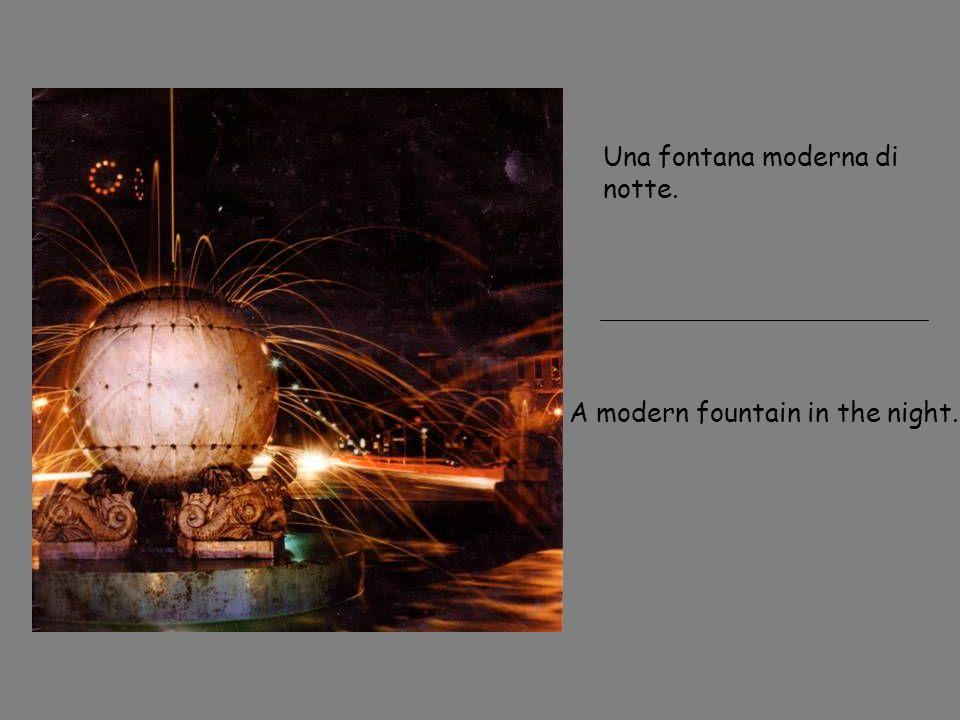 Una fontana moderna di notte. A modern fountain in the night.
