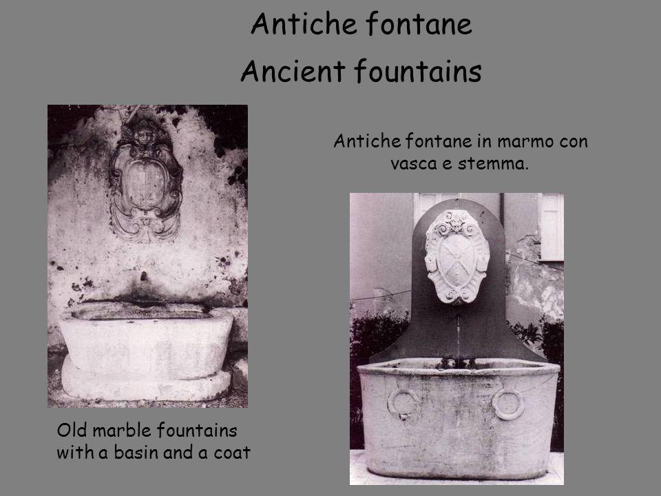 Antiche fontane in marmo con vasca e stemma. Antiche fontane Ancient fountains Old marble fountains with a basin and a coat