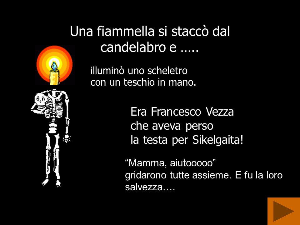 Una fiammella si staccò dal candelabro e …..illuminò uno scheletro con un teschio in mano.