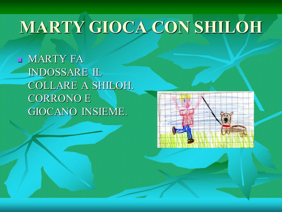 MARTY GIOCA CON SHILOH MARTY FA INDOSSARE IL COLLARE A SHILOH. CORRONO E GIOCANO INSIEME.
