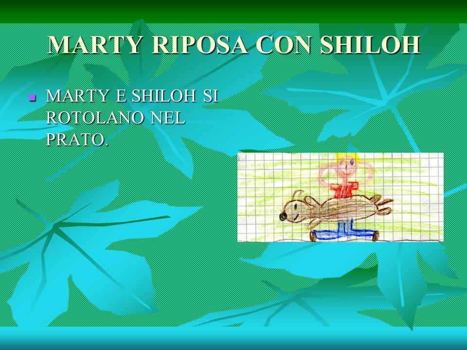 MARTY RIPOSA CON SHILOH MARTY E SHILOH SI ROTOLANO NEL PRATO.