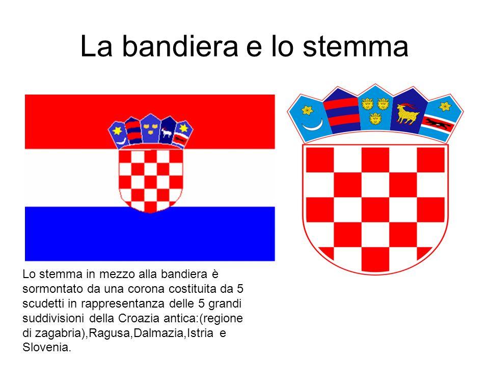 La bandiera e lo stemma Lo stemma in mezzo alla bandiera è sormontato da una corona costituita da 5 scudetti in rappresentanza delle 5 grandi suddivisioni della Croazia antica:(regione di zagabria),Ragusa,Dalmazia,Istria e Slovenia.