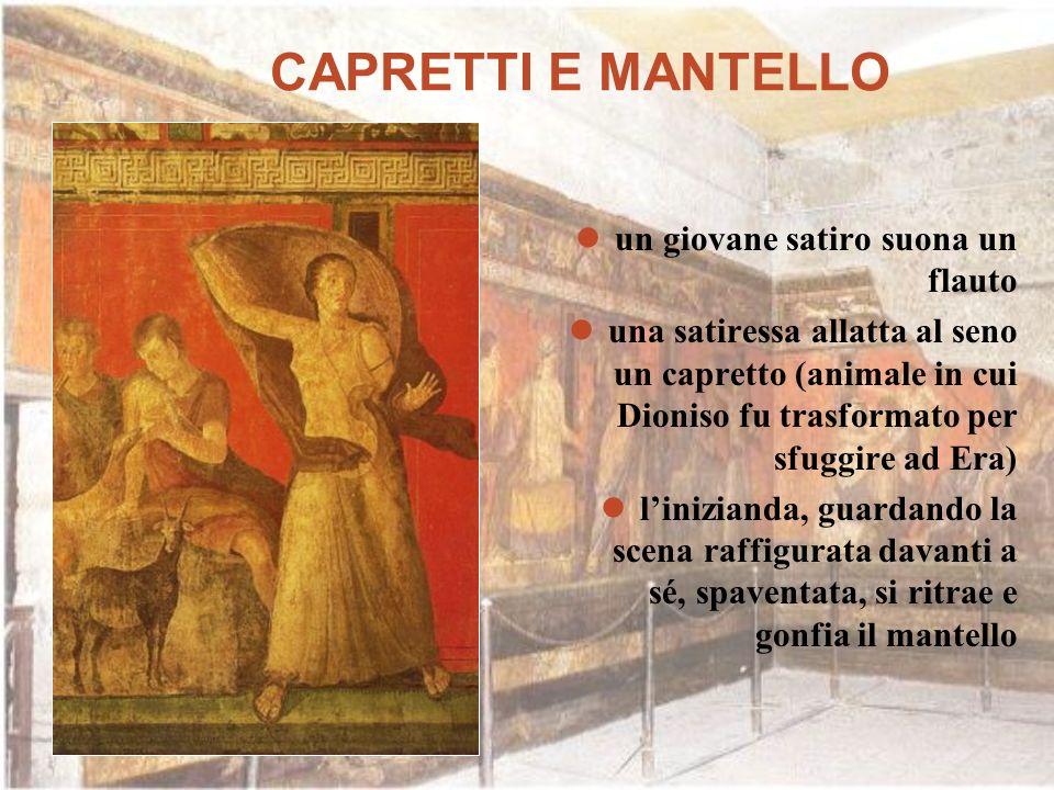 CAPRETTI E MANTELLO un giovane satiro suona un flauto una satiressa allatta al seno un capretto (animale in cui Dioniso fu trasformato per sfuggire ad