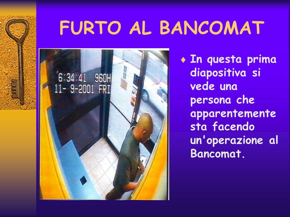 FURTO AL BANCOMAT In questa prima diapositiva si vede una persona che apparentemente sta facendo un'operazione al Bancomat.