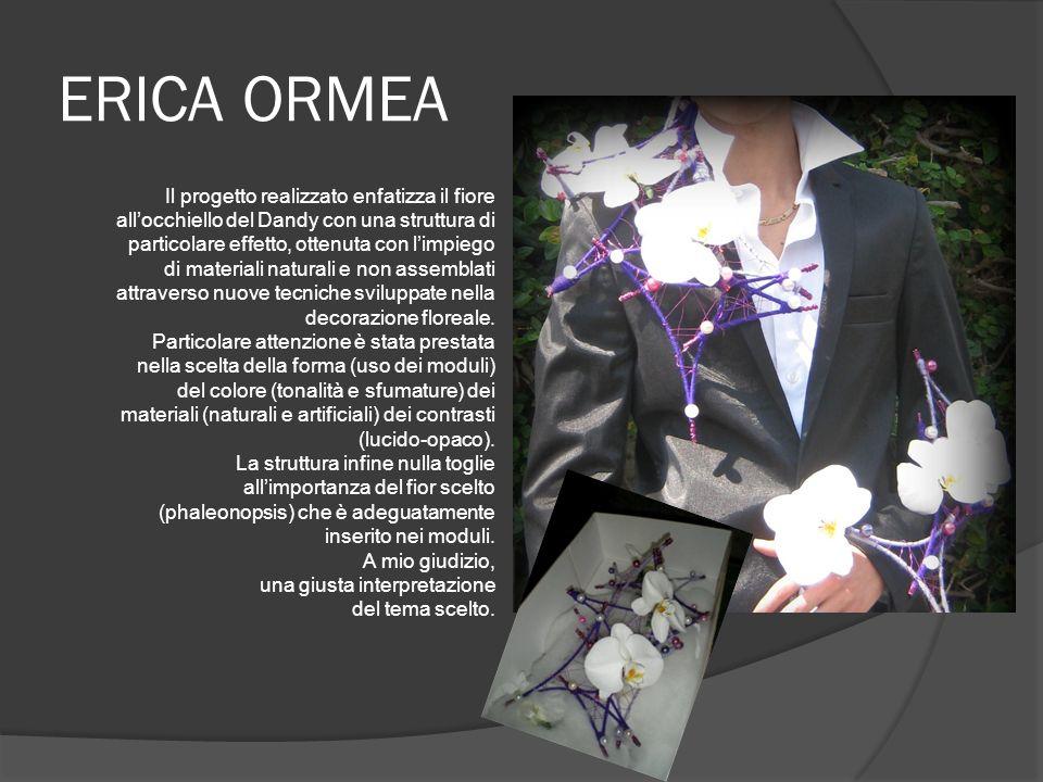 ERICA ORMEA Il progetto realizzato enfatizza il fiore allocchiello del Dandy con una struttura di particolare effetto, ottenuta con limpiego di materiali naturali e non assemblati attraverso nuove tecniche sviluppate nella decorazione floreale.