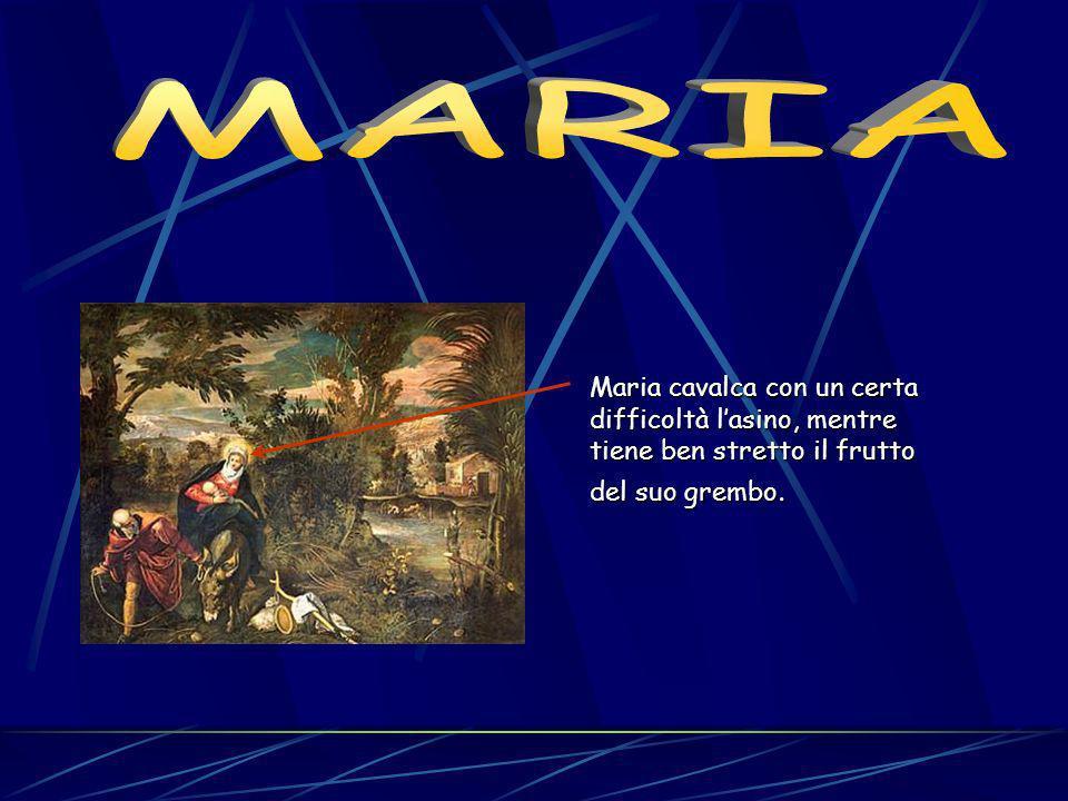 Maria cavalca con un certa difficoltà lasino, mentre tiene ben stretto il frutto del suo grembo.