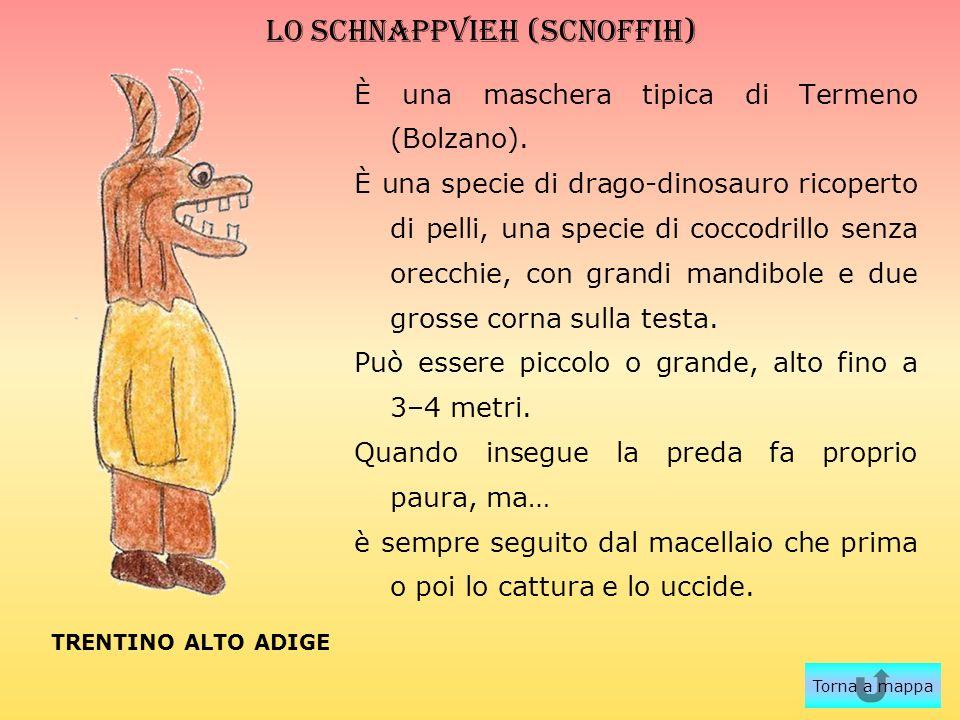LO SCHNAPPVIEH (scnoffih) È una maschera tipica di Termeno (Bolzano). È una specie di drago-dinosauro ricoperto di pelli, una specie di coccodrillo se