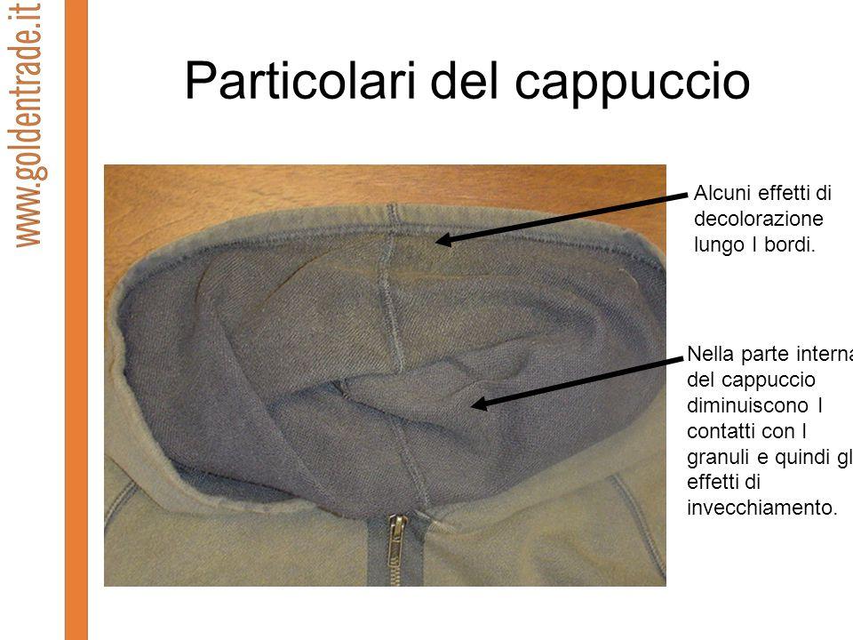 Particolari del cappuccio Alcuni effetti di decolorazione lungo I bordi. Nella parte interna del cappuccio diminuiscono I contatti con I granuli e qui