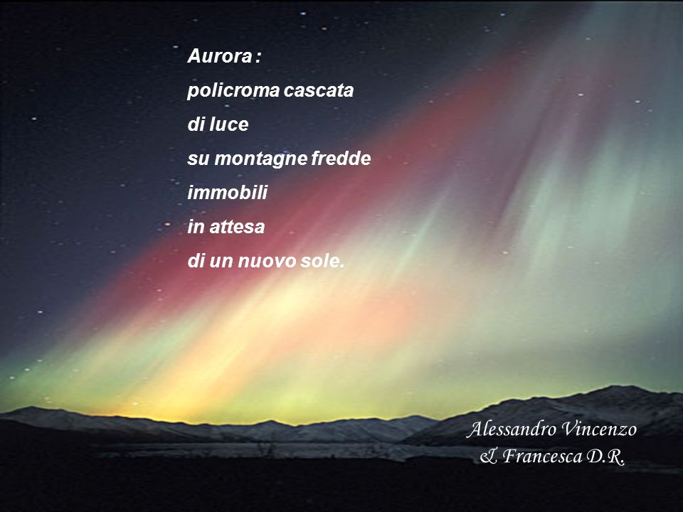 Aurora : policroma cascata di luce su montagne fredde immobili in attesa di un nuovo sole. Alessandro Vincenzo & Francesca D.R.