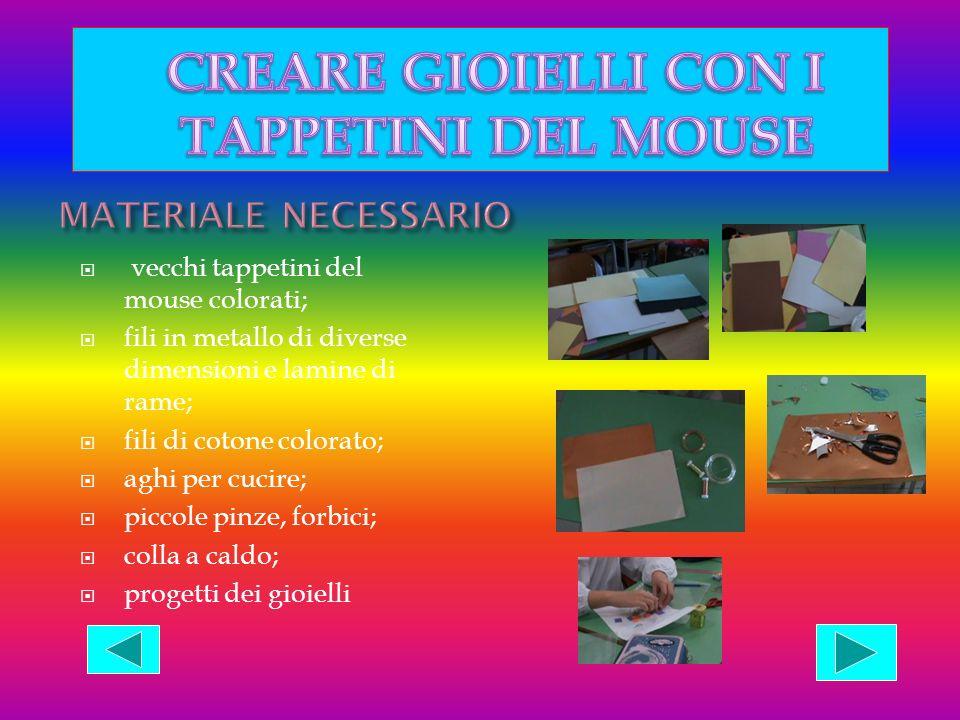 vecchi tappetini del mouse colorati; fili in metallo di diverse dimensioni e lamine di rame; fili di cotone colorato; aghi per cucire; piccole pinze,