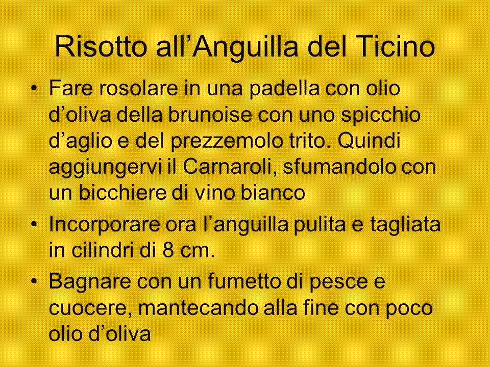 Risotto allAnguilla del Ticino Fare rosolare in una padella con olio doliva della brunoise con uno spicchio daglio e del prezzemolo trito. Quindi aggi