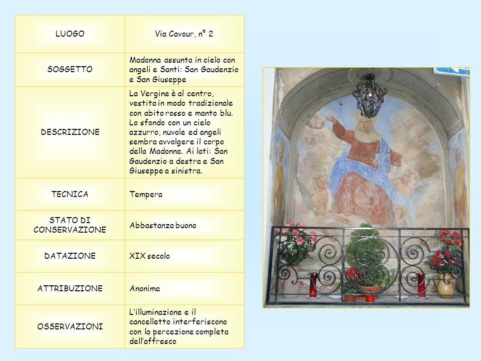 LUOGOVia Cavour, n° 2 SOGGETTO Madonna assunta in cielo con angeli e Santi: San Gaudenzio e San Giuseppe DESCRIZIONE La Vergine è al centro, vestita in modo tradizionale con abito rosso e manto blu.