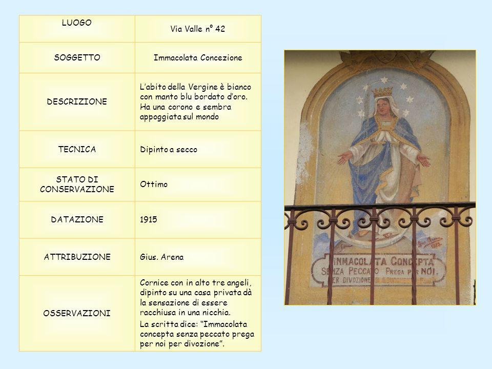 LUOGO Via Valle n° 42 SOGGETTOImmacolata Concezione DESCRIZIONE Labito della Vergine è bianco con manto blu bordato doro. Ha una corono e sembra appog