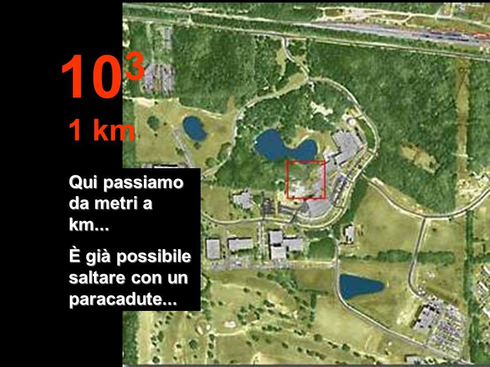 A questa distanza già possiamo vedere la foresta ben definita, una parte di lago e gli edifici 10 2 100 metri