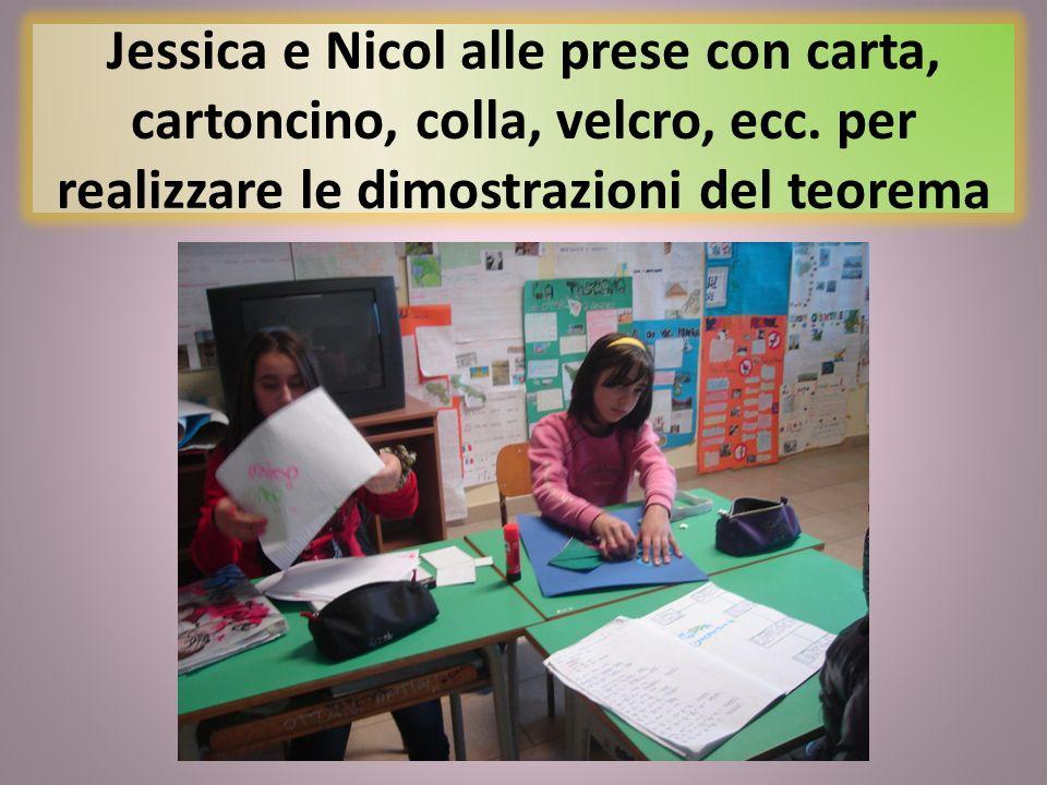 Jessica e Nicol alle prese con carta, cartoncino, colla, velcro, ecc. per realizzare le dimostrazioni del teorema