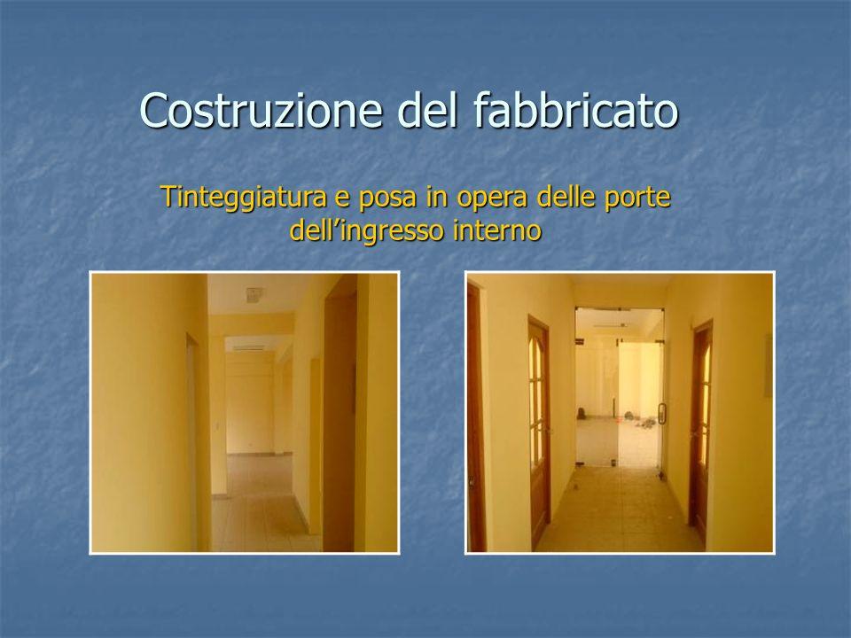 Costruzione del fabbricato Tinteggiatura e posa in opera delle porte dellingresso interno