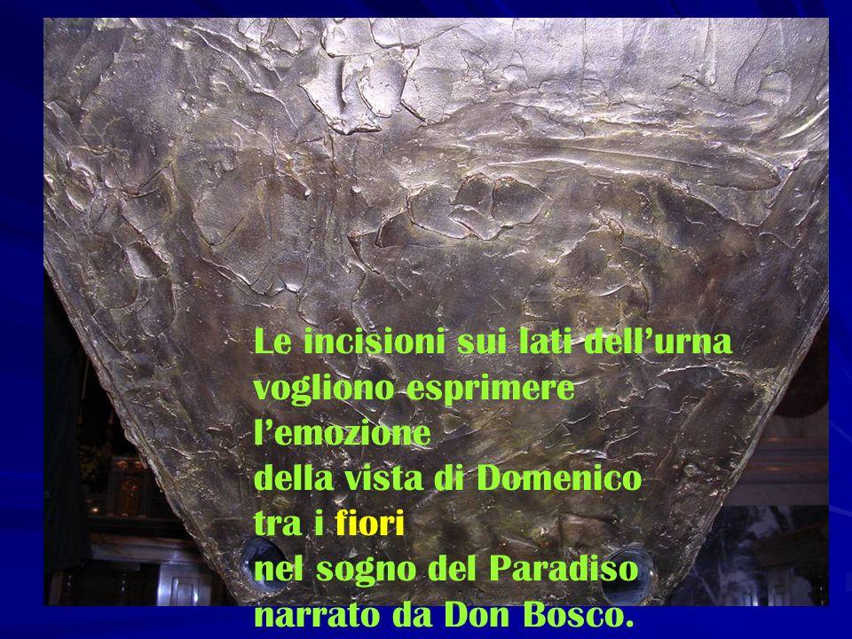 Le incisioni sui lati dellurna vogliono esprimere lemozione della vista di Domenico tra i fiori nel sogno del Paradiso narrato da Don Bosco.