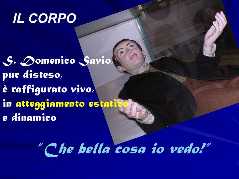 S. Domenico Savio, pur disteso, è raffigurato vivo, in atteggiamento estatico e dinamico Che bella cosa io vedo! IL CORPO