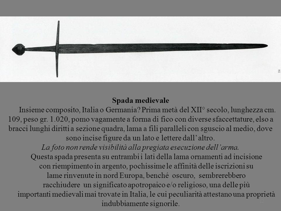 12 Spada medievale Insieme composito, Italia o Germania? Prima metà del XII° secolo, lunghezza cm. 109, peso gr. 1.020, pomo vagamente a forma di fico