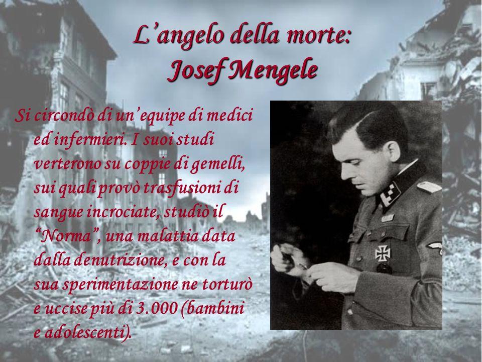 Langelo della morte: Josef Mengele Si circondò di unequipe di medici ed infermieri. I suoi studi verterono su coppie di gemelli, sui quali provò trasf