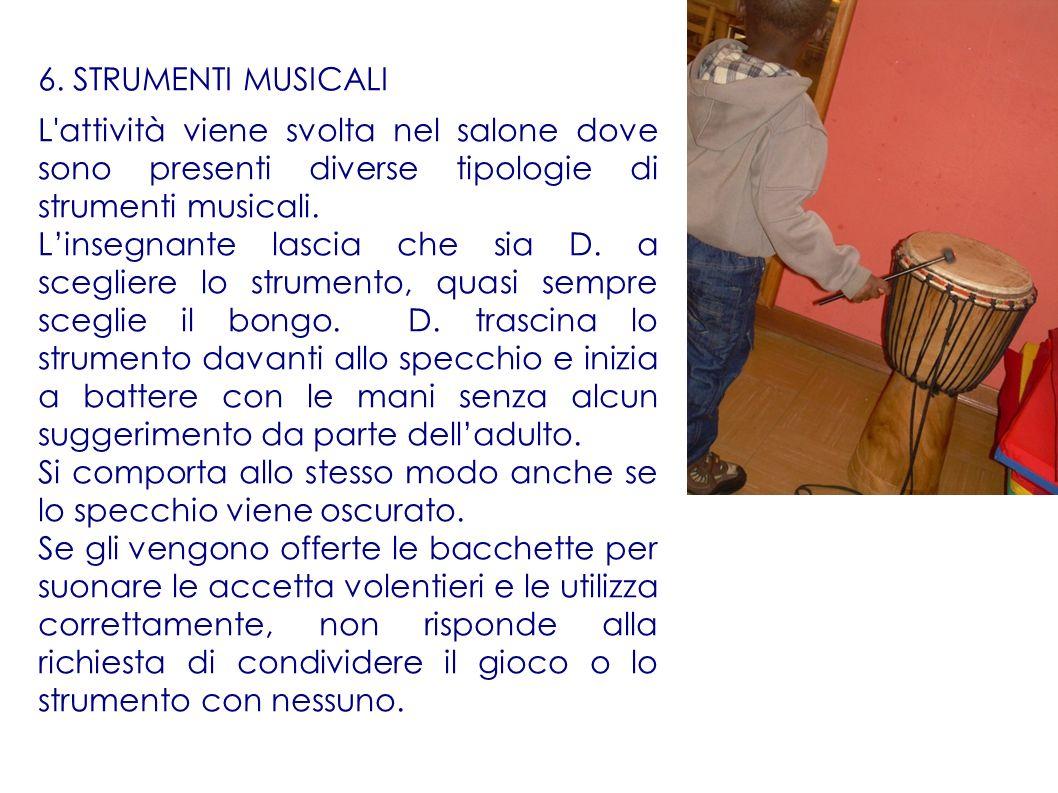 6. STRUMENTI MUSICALI L'attività viene svolta nel salone dove sono presenti diverse tipologie di strumenti musicali. Linsegnante lascia che sia D. a s