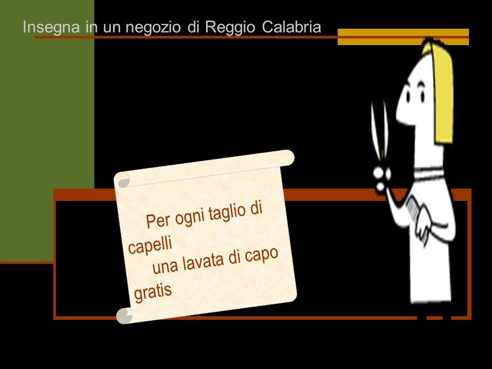 Insegna in un negozio di Reggio Calabria Per ogni taglio di capelli una lavata di capo gratis