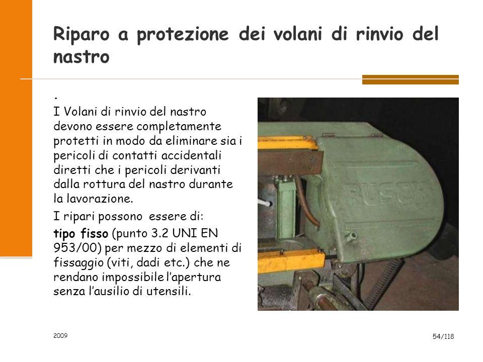 2009 54/118 Riparo a protezione dei volani di rinvio del nastro. I Volani di rinvio del nastro devono essere completamente protetti in modo da elimina