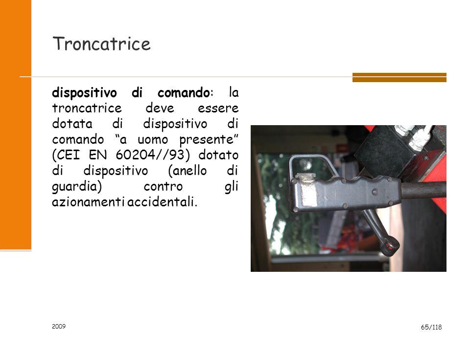 2009 65/118 Troncatrice dispositivo di comando: la troncatrice deve essere dotata di dispositivo di comando a uomo presente (CEI EN 60204//93) dotato di dispositivo (anello di guardia) contro gli azionamenti accidentali.
