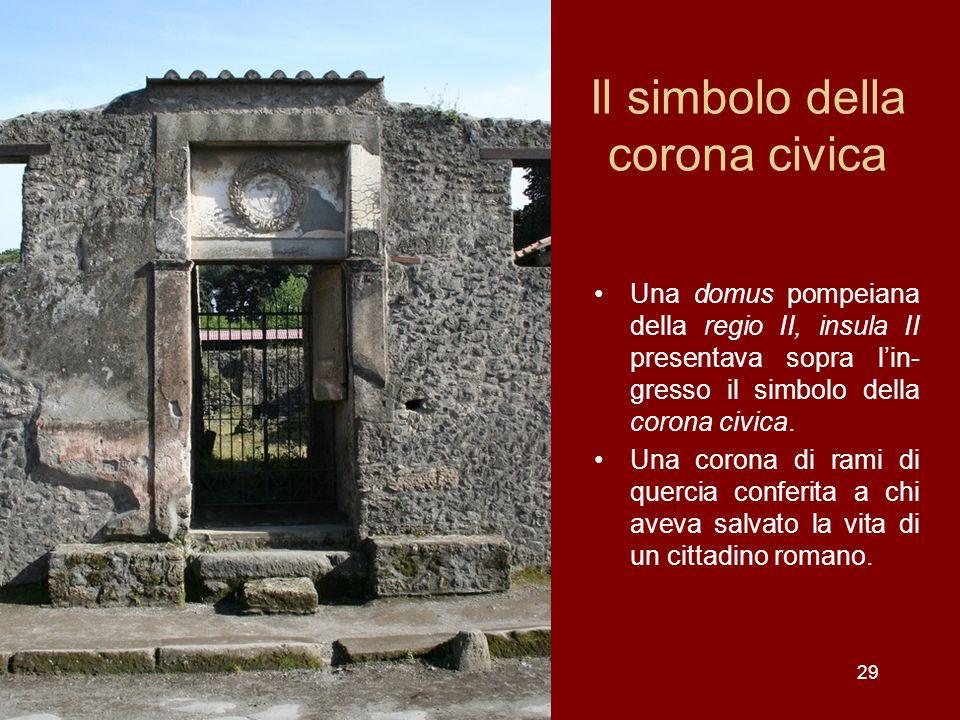 Il simbolo della corona civica Una domus pompeiana della regio II, insula II presentava sopra lin- gresso il simbolo della corona civica. Una corona d