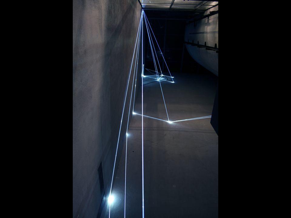 CARLO BERNARDINI-MANU SOBRAL, LA QUARTA DIREZIONE DELLO SPAZIO 2008, project 2004, fibre ottiche, video interattivi, audio, m h 3x5x13; Milano, Galleria Bruna Soletti.