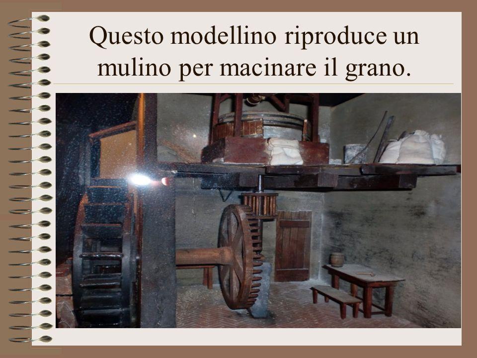 Questo modellino riproduce un mulino per macinare il grano.