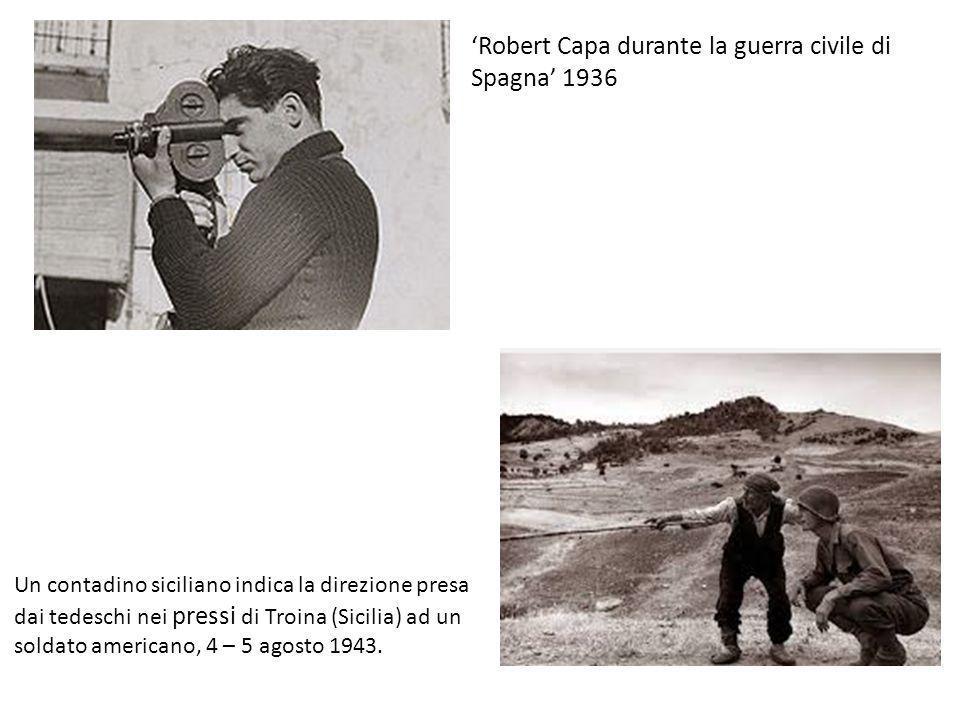 Robert Capa durante la guerra civile di Spagna 1936 Un contadino siciliano indica la direzione presa dai tedeschi nei pressi di Troina (Sicilia) ad un soldato americano, 4 – 5 agosto 1943.