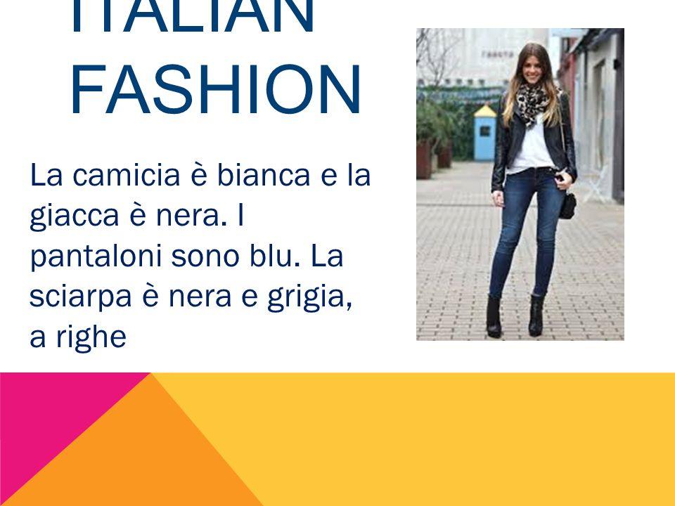 ITALIAN FASHION La camicia è bianca e la giacca è nera. I pantaloni sono blu. La sciarpa è nera e grigia, a righe