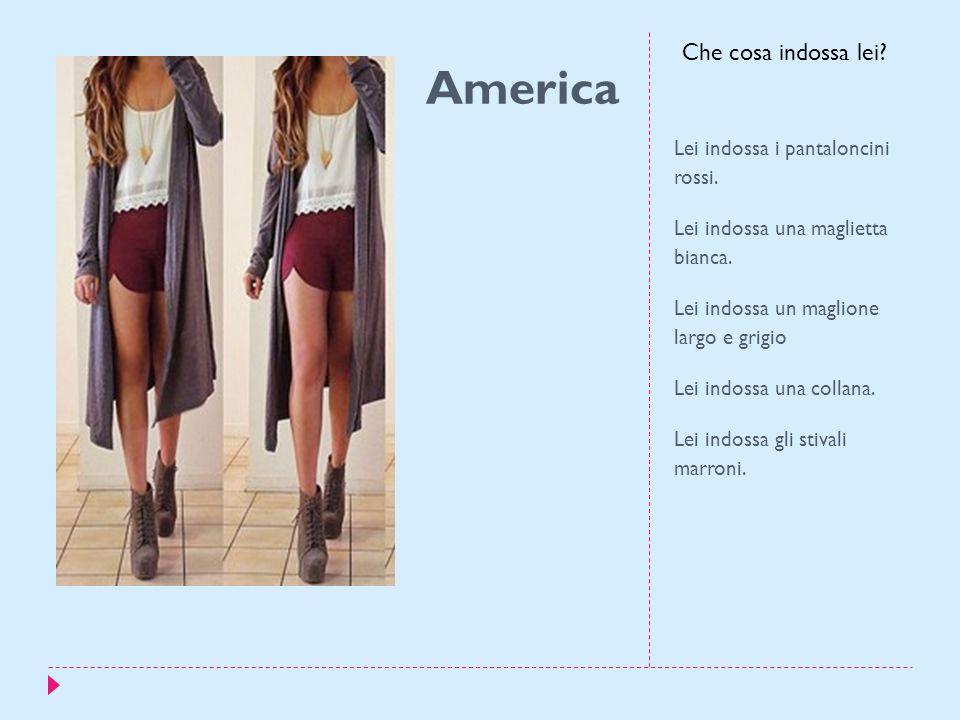 America Lei indossa i pantaloncini rossi. Lei indossa una maglietta bianca.