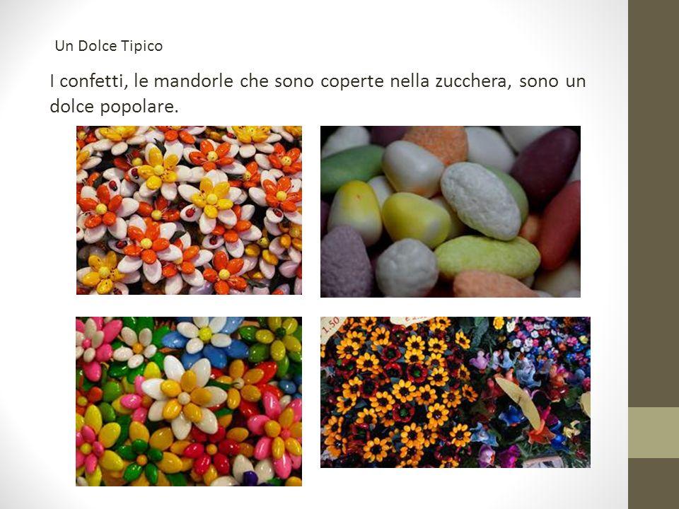 I confetti, le mandorle che sono coperte nella zucchera, sono un dolce popolare. Un Dolce Tipico