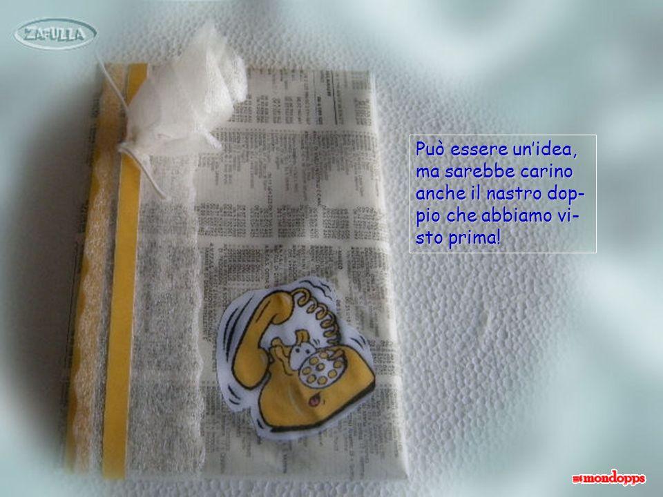 Con una striscia della solita carta plastificata confeziono una rosel- lina che lego con un pezzettino di spago bianco, poi incollo allangolo.