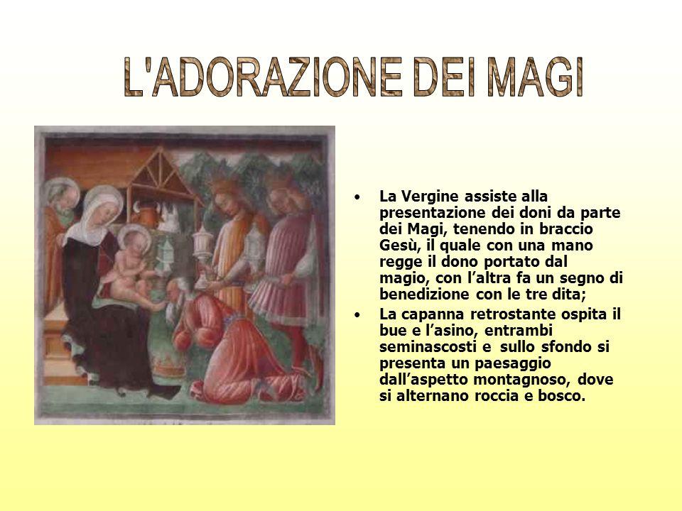 La Vergine assiste alla presentazione dei doni da parte dei Magi, tenendo in braccio Gesù, il quale con una mano regge il dono portato dal magio, con
