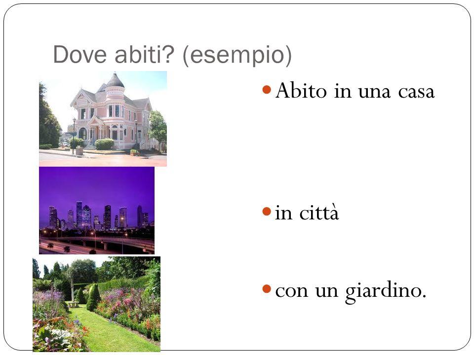 Dove abiti? (esempio) Abito in una casa in città con un giardino.