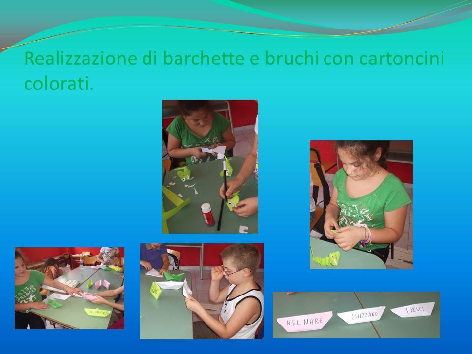 Realizzazione di barchette e bruchi con cartoncini colorati.