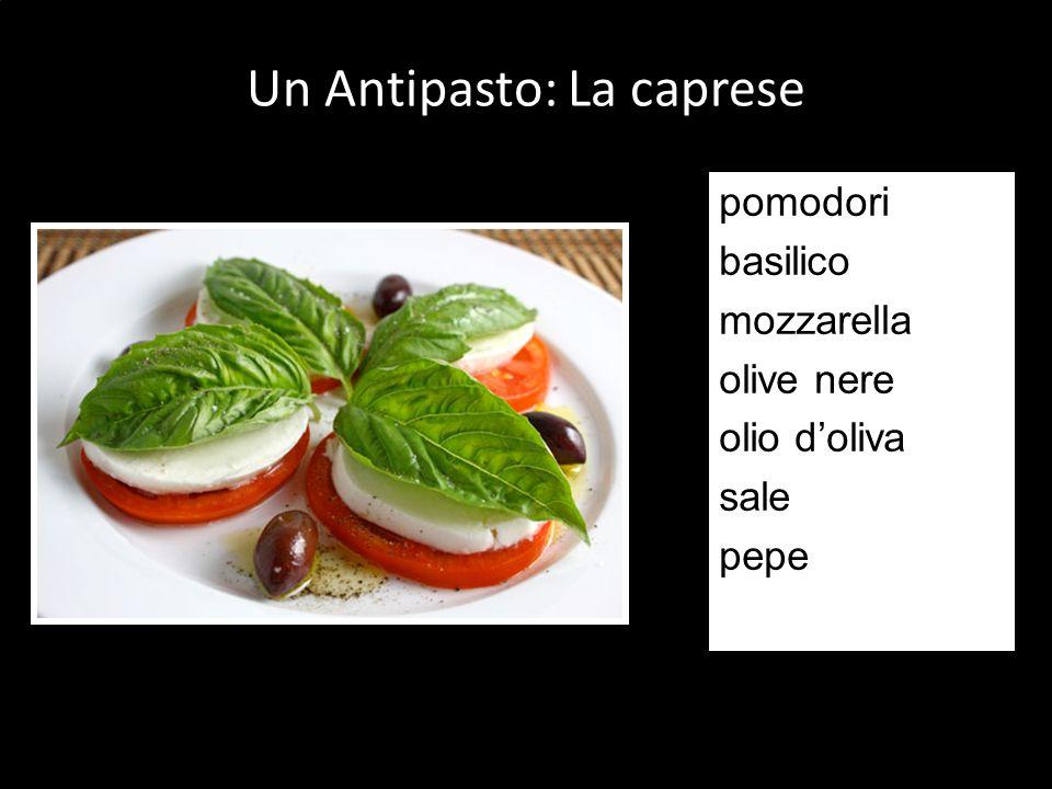 pomodori basilico mozzarella olive nere olio doliva sale pepe Un Antipasto: La caprese