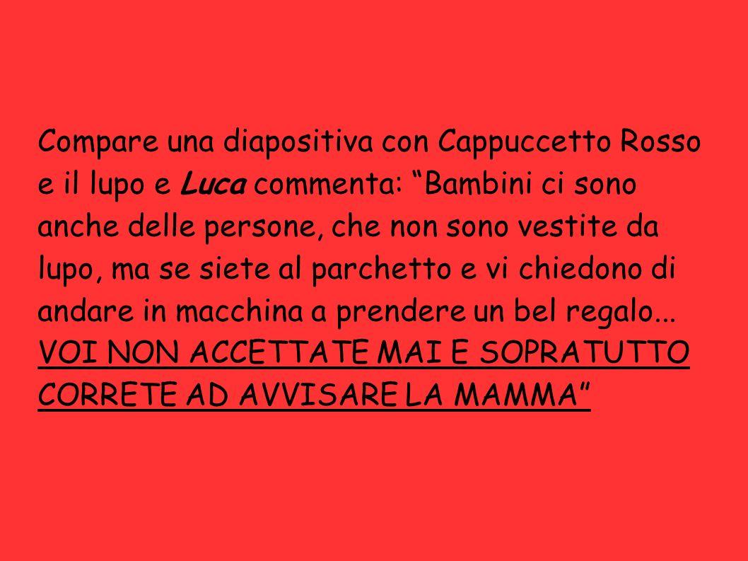Compare una diapositiva con Cappuccetto Rosso e il lupo e Luca commenta: Bambini ci sono anche delle persone, che non sono vestite da lupo, ma se siet