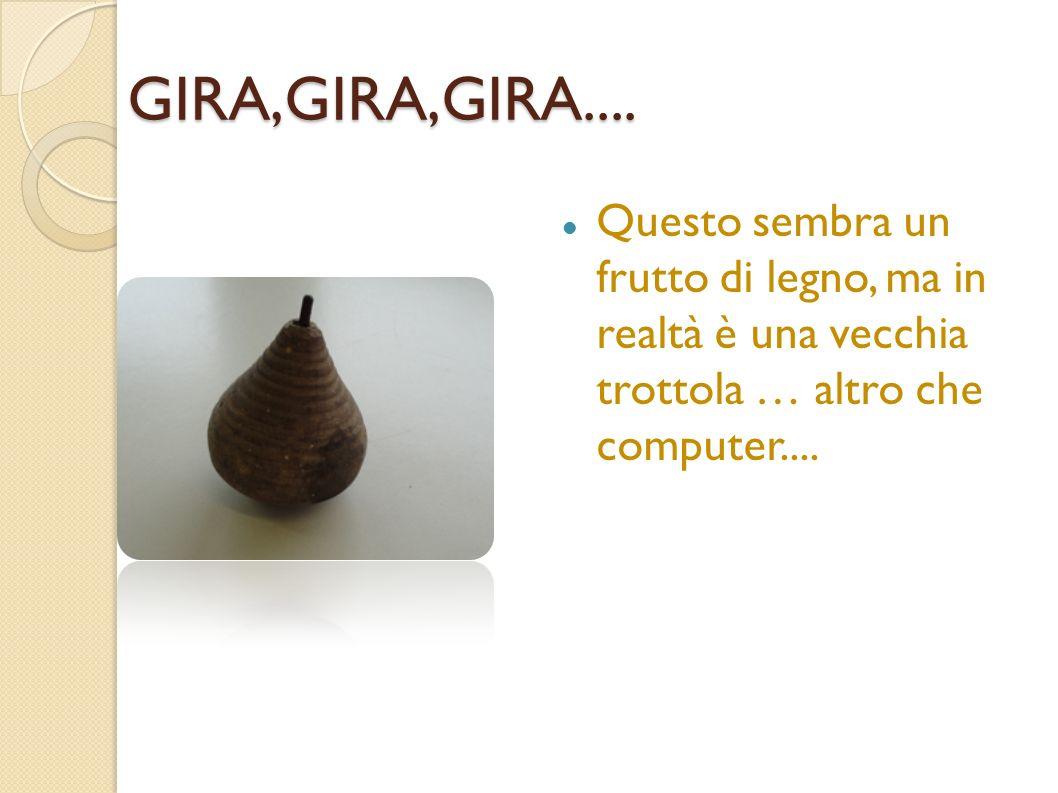 GIRA,GIRA,GIRA.... Questo sembra un frutto di legno, ma in realtà è una vecchia trottola … altro che computer....