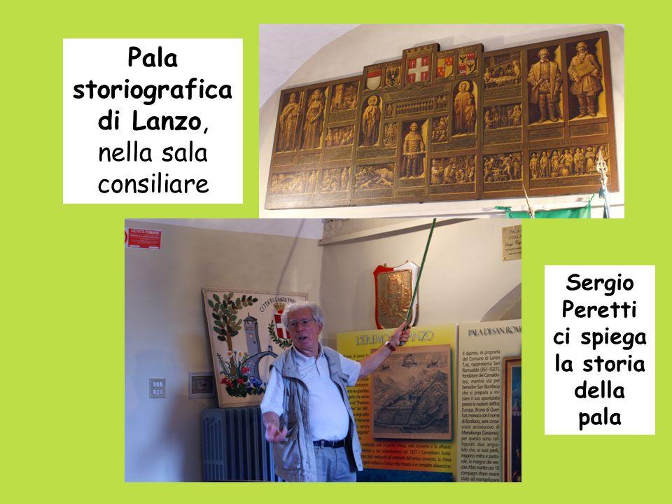 Pala storiografica di Lanzo, nella sala consiliare Sergio Peretti ci spiega la storia della pala