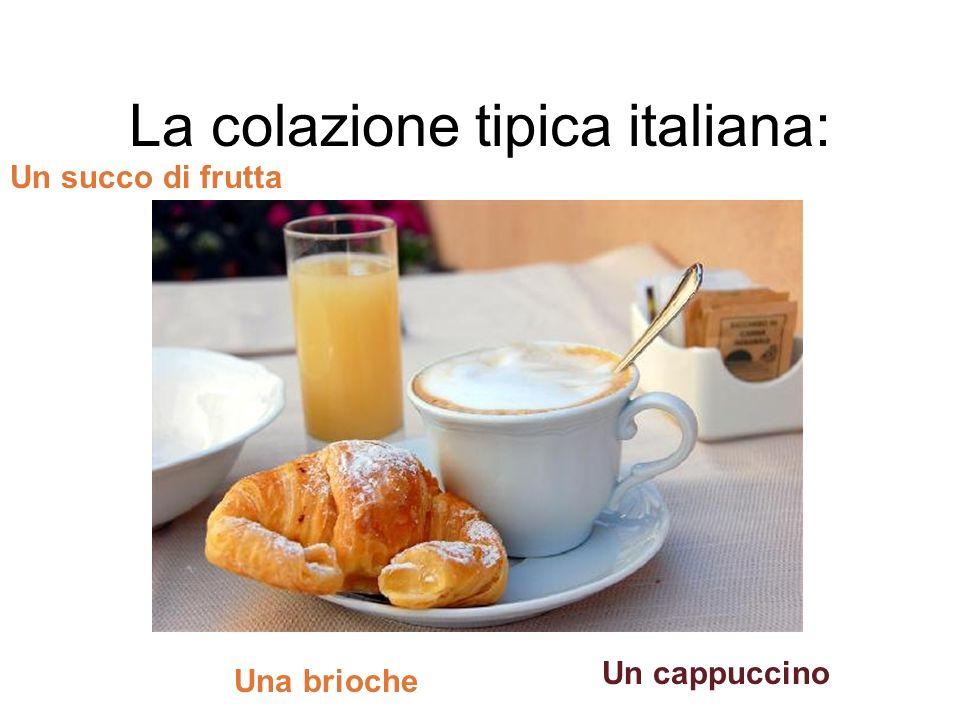 La colazione tipica italiana: Un cappuccino Un succo di frutta Una brioche
