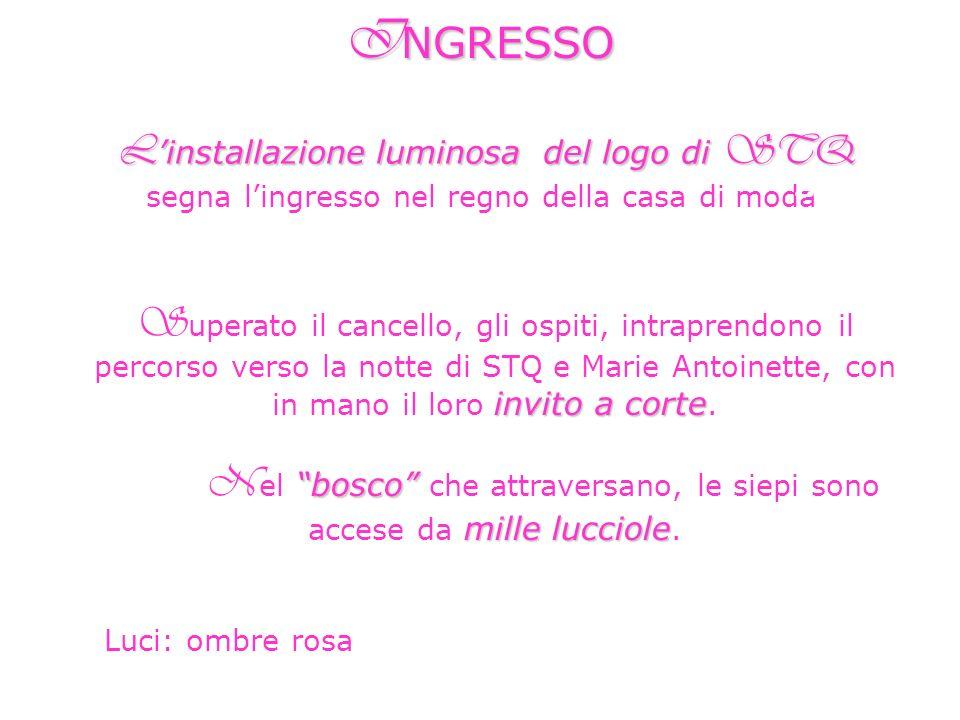 L installazione luminosa del logo di STQ L installazione luminosa del logo di STQ segna lingresso nel regno della casa di moda. I NGRESSO invito a cor