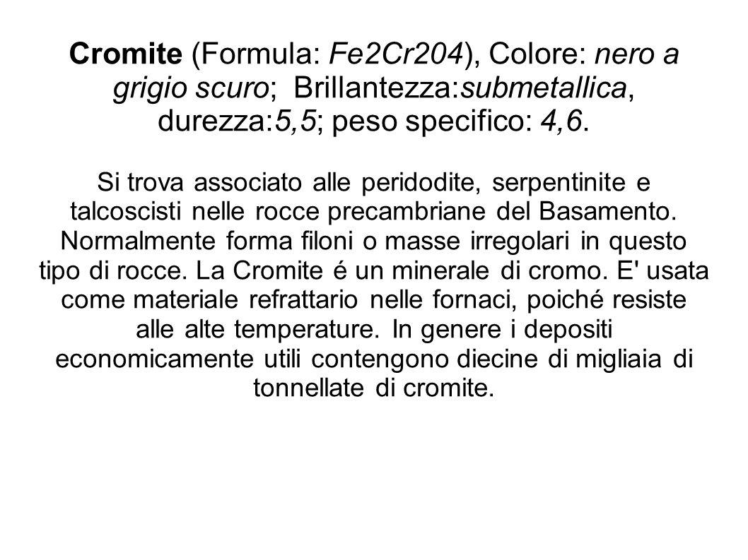 Cromite (Formula: Fe2Cr204), Colore: nero a grigio scuro; Brillantezza:submetallica, durezza:5,5; peso specifico: 4,6. Si trova associato alle peridod